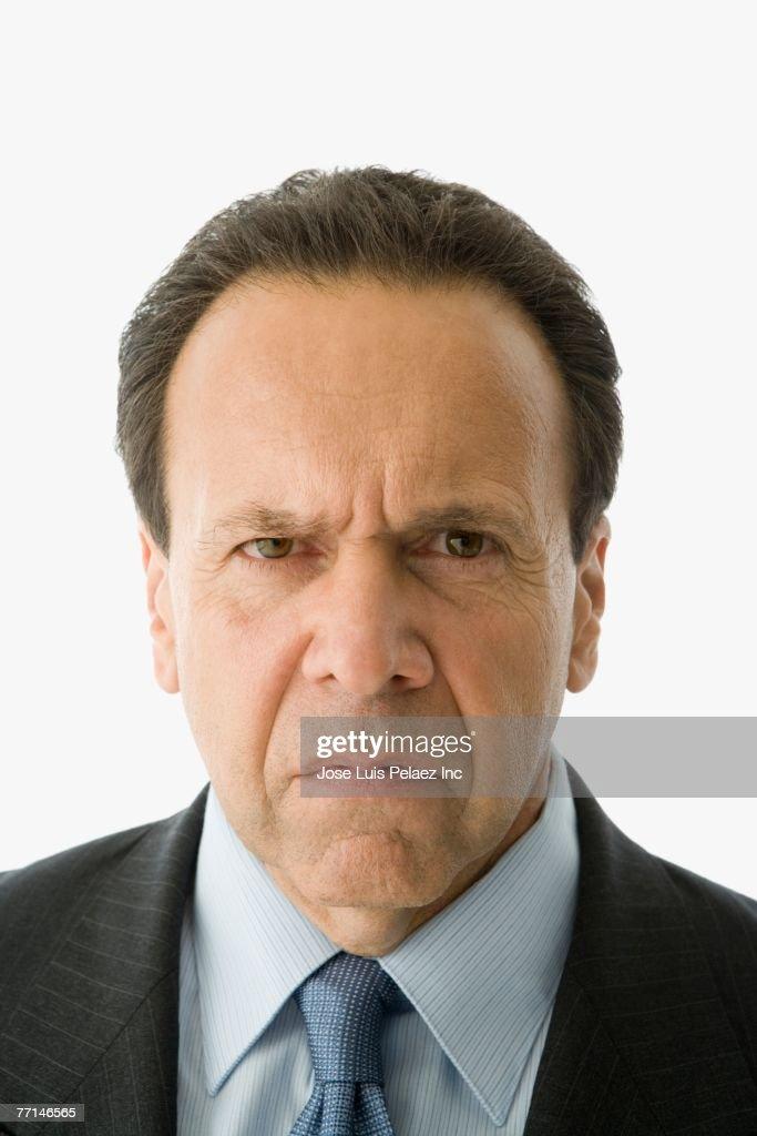 Hispanic businessman looking angry : Stock Photo