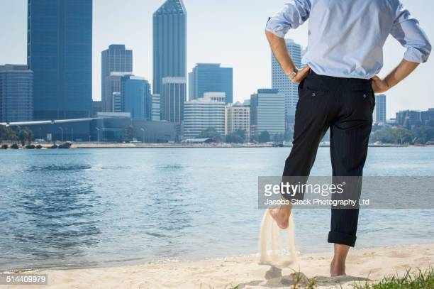 Hispanic businessman playing on beach, Perth, Western Australia, Australia