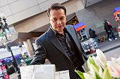 Hispanic businessman shopping flowers in a market