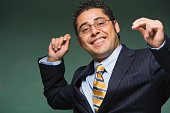 Hispanic businessman smiling and snapping fingers