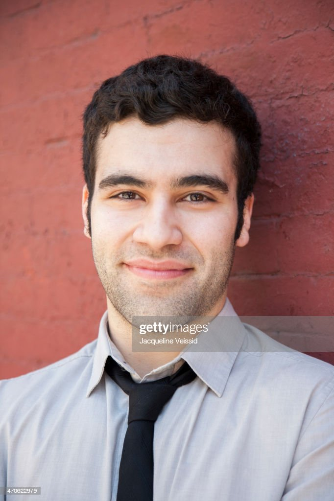 Hispanic businessman smiling outdoors : Stock Photo