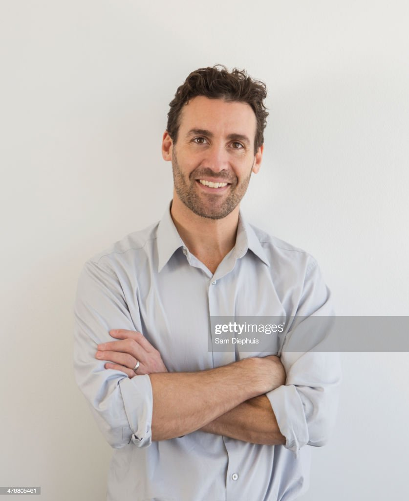 Hispanic businessman smiling : Stock Photo