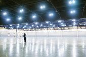 Hispanic businessman standing in empty warehouse