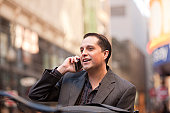 Hispanic businessman talking on a mobile phone