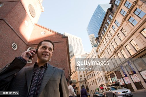 Hispanic businessman talking on a mobile phone : Stock Photo