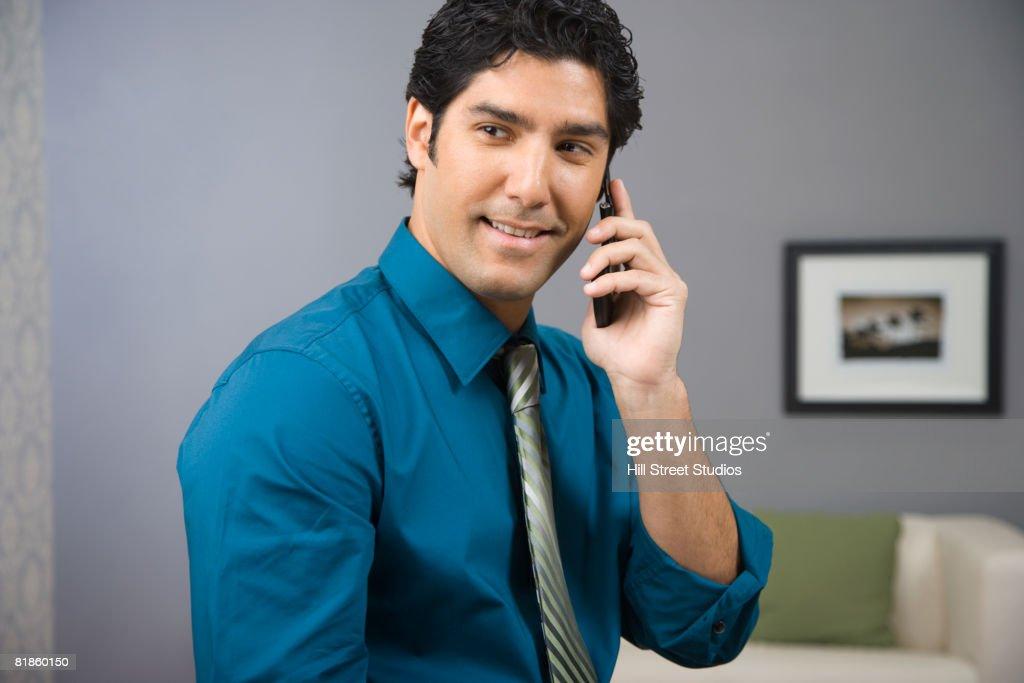 Hispanic businessman talking on cell phone : Stock Photo