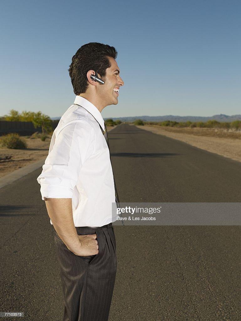 Hispanic businessman using hands free device : Stock Photo