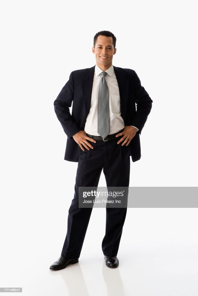 Hispanic businessman with hands on hips