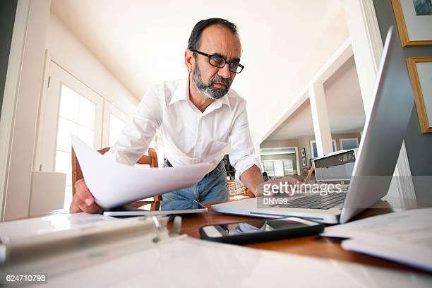Hispanic Businessman Working From Home