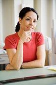 Hispanic businesswoman at desk