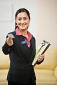 Hispanic businesswoman offering business card