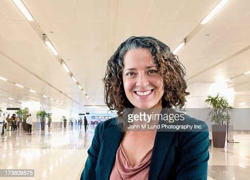 Hispanic businesswoman smiling in office : Stock Photo