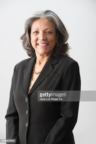 Hispanic businesswoman smiling