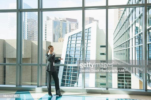 Hispanic businesswoman talking on cell phone : Stock Photo