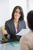 Hispanic businesswoman talking to job applicant