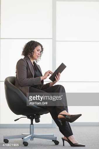 Hispanic businesswoman using digital tablet