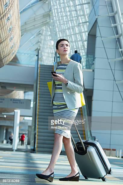 Hispanic businesswoman walking in airport