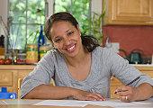 Hispanic businesswoman working at home