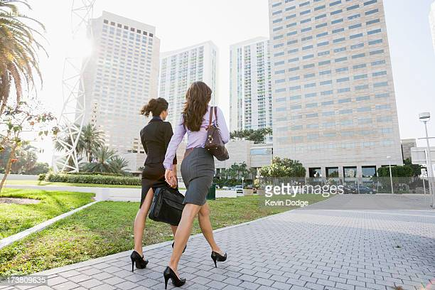 Hispanic businesswomen walking together