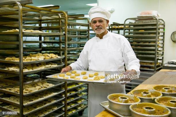 Hispanic chef baking in commercial kitchen