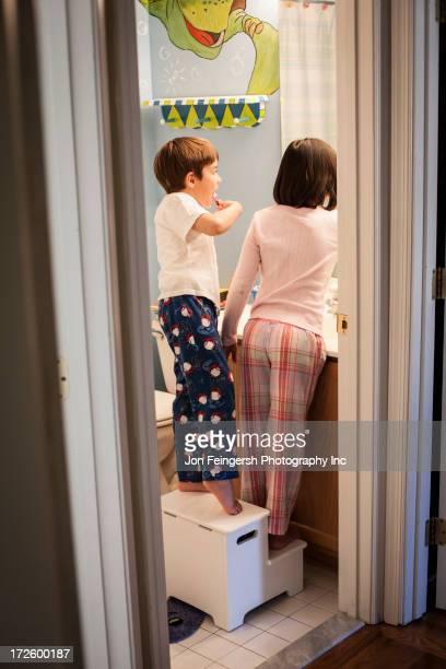 Hispanic children brushing their teeth