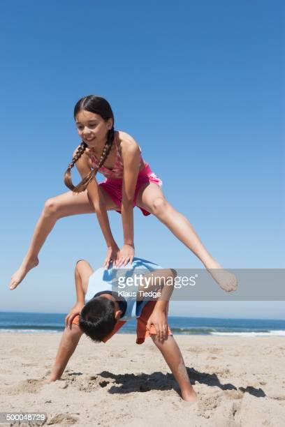 Hispanic children playing on beach