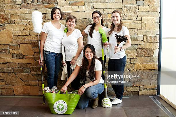 Hispanic cleaning crew smiling together