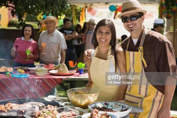 Hispanic couple at family barbecue