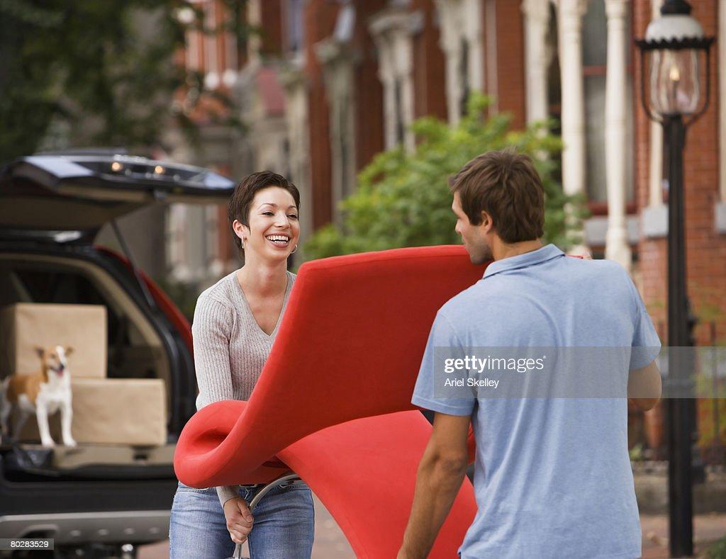 Hispanic couple carrying furniture : Stock Photo