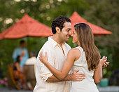 Hispanic couple dancing outdoors