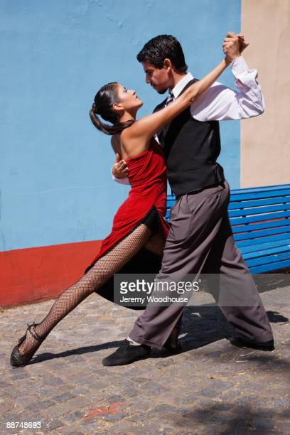 Hispanic couple doing tango outdoors