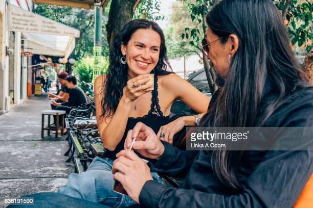 Hispanic Couple enjoying coffee outside