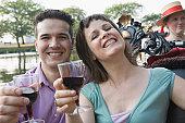 Hispanic couple holding glasses of wine in a gondola, Boston, Massachusetts, USA