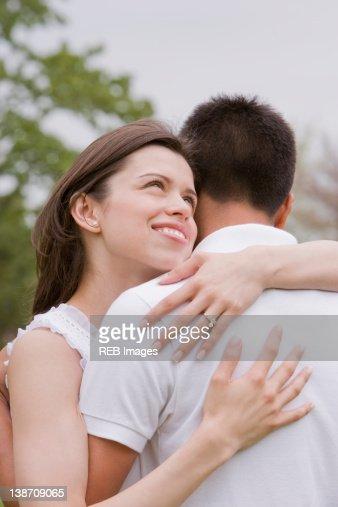 hispanic couple hugging outdoors royalty free stock images