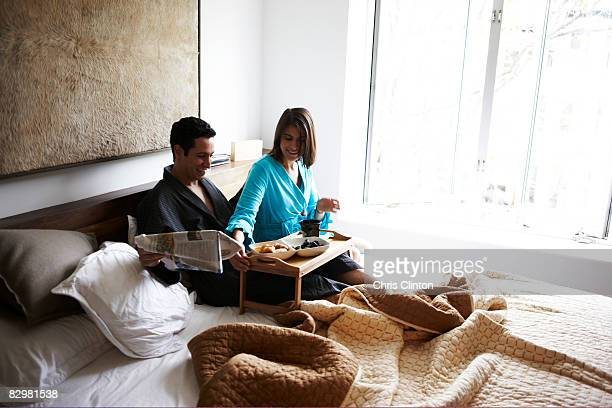 Hispanic couple in luxury bedroom