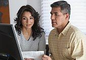 Hispanic couple looking at computer