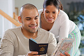 Hispanic couple planning for vacations