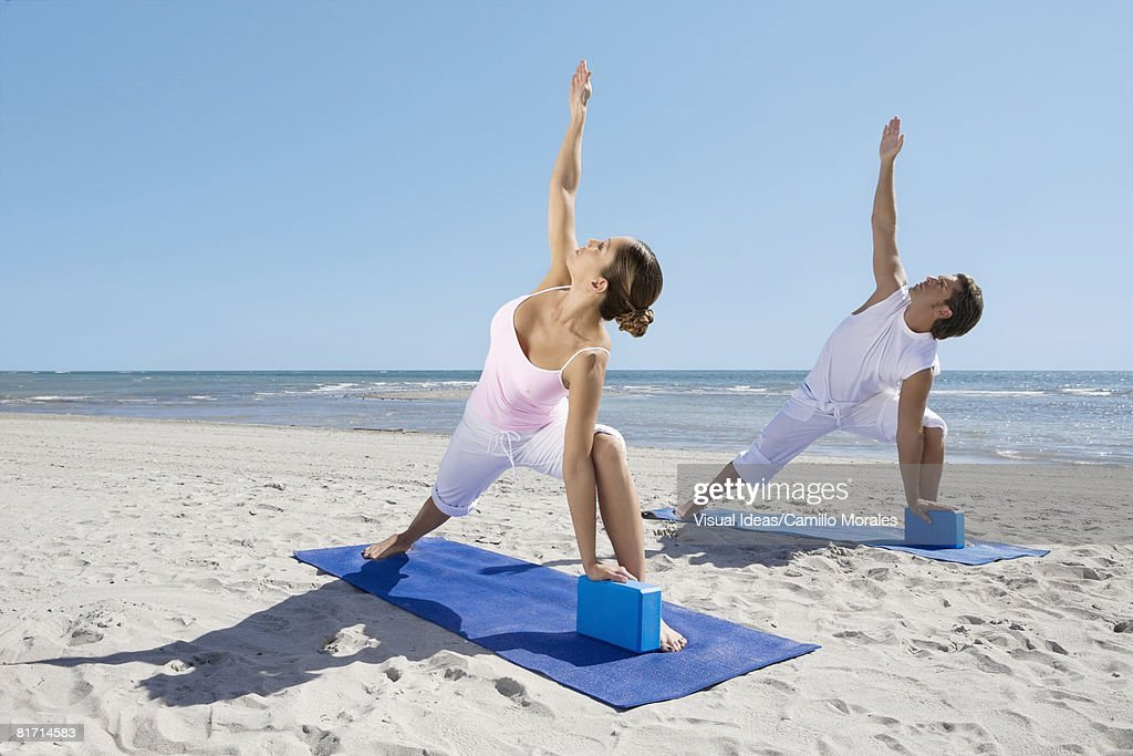Hispanic couple practicing yoga : Stock Photo