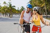 Hispanic couple riding bicycles