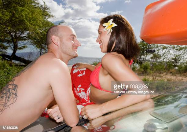 Hispanic couple smiling at each other