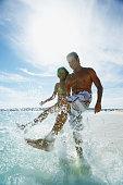 Hispanic couple splashing water