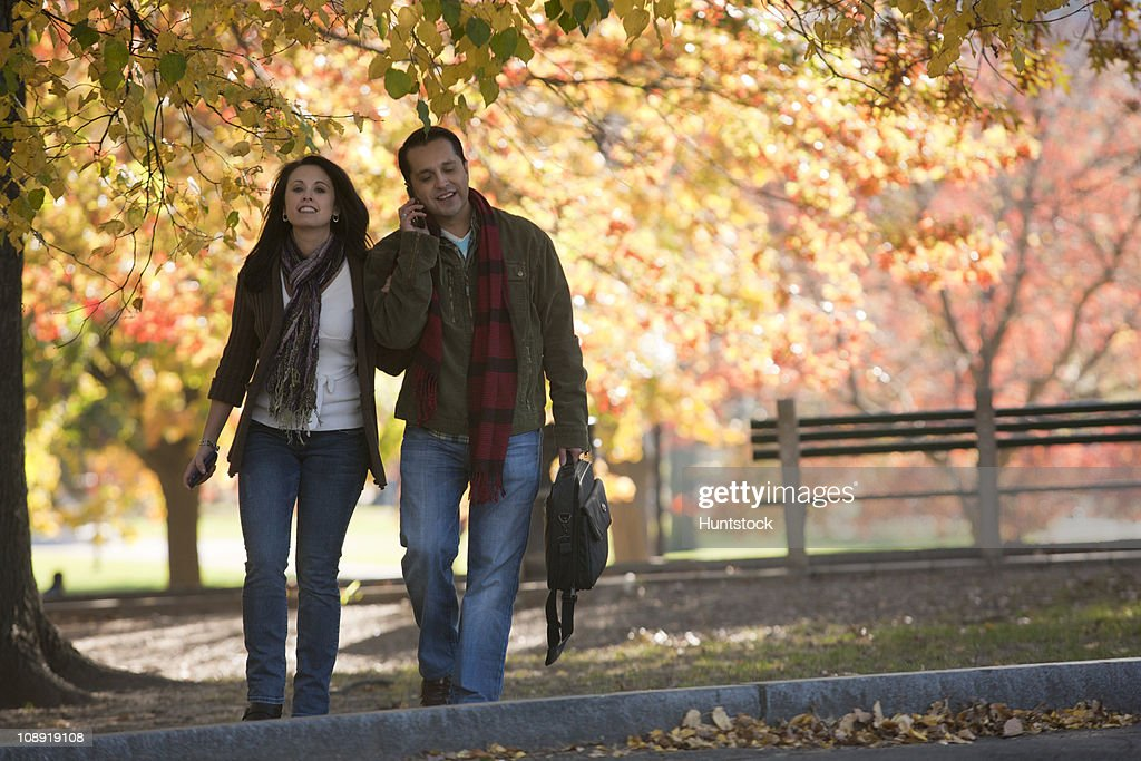 Hispanic couple walking in a park