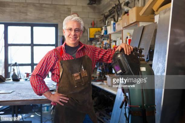 Hispanic craftsman working in shop