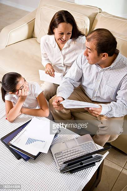 Hispanic family at home reviewing finances