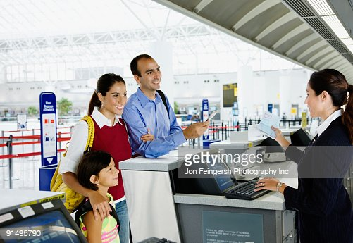 Hispanic family checking in at airport
