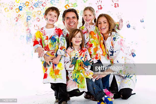 Hispanic family covered in paint