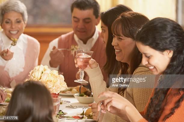 Hispanic family eating at the dinner table
