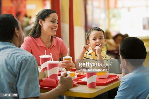 Hispanic family eating in fast food restaurant