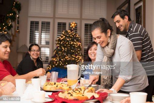 Hispanic family enjoying traditional Christmas dessert