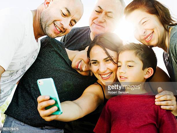 A hispanic family enjoys time together at a park in San Diego, Ca.